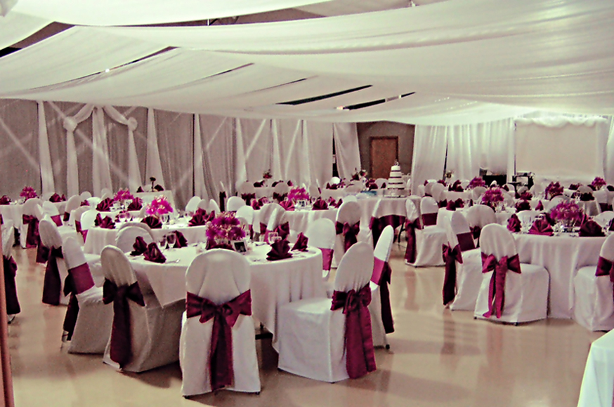 Cranberry Colored Wedding Reception Room View With Centerpieces By Wanderfuls.