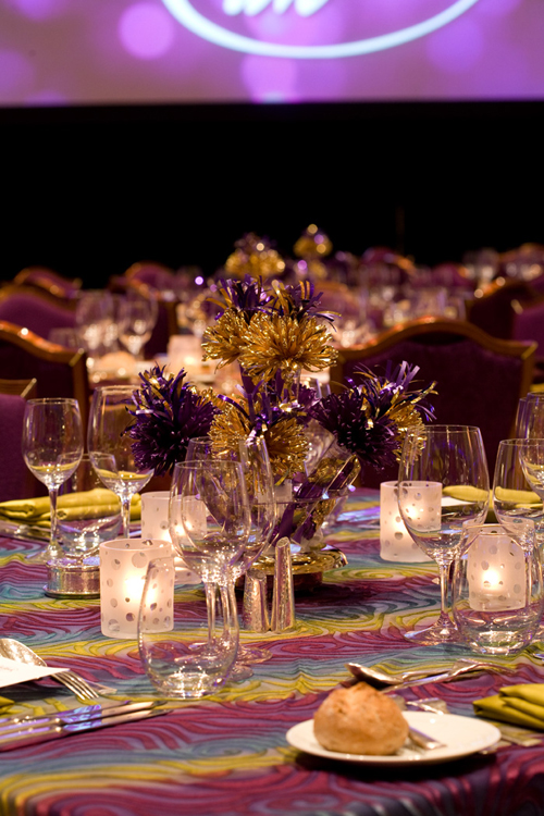 President's Circle Annual Party With Wanderfuls Centerpieces In Gold And Purple.