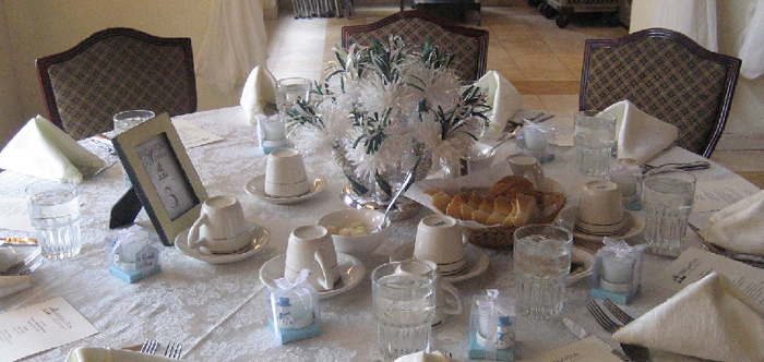 White And Teal Wanderfuls Centerpiece At Marissa's Tea Party Wedding Shower.