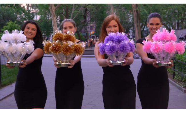 Wanderfuls ladies holding a variety of bouquet centerpieces